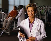 Picture of a physical therapist in an exercise room