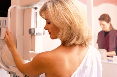 Photo of woman having mammogram.
