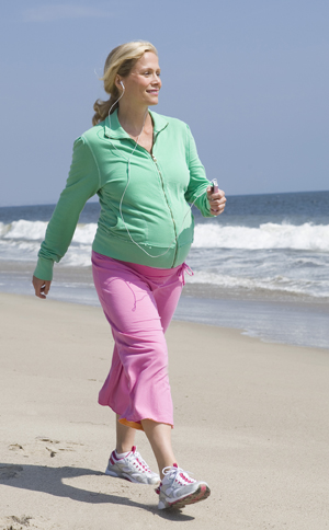 Pregnant woman walking outdoors.