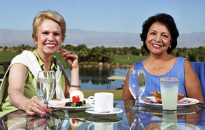 Two women having lunch at outdoor restaurant.