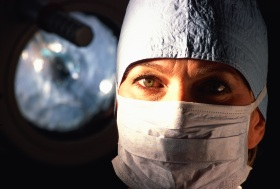 Female surgeon wearing a mask