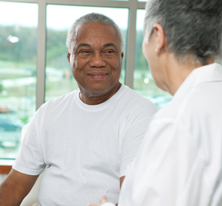 Older man talking with his doctor