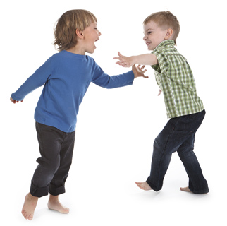 Two toddler boys playing together.