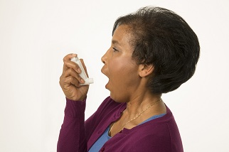 Woman holding inhaler, preparing to use it