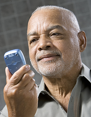Man checking blood glucose