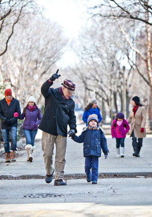 Grandfather walking with a child outdoors in the winter