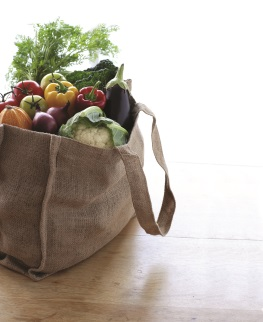 Cloth grocery bag on the floor and filled with vegetables
