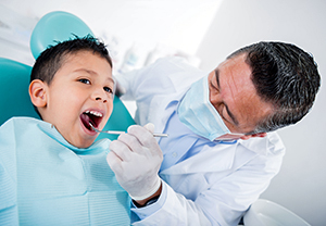 Boy being examined by dentist.