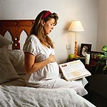 Picture of an expectant mother, reading