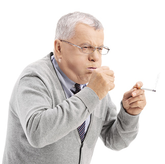 Older man with a cigarette in his hand, hunched over coughing into his other hand.