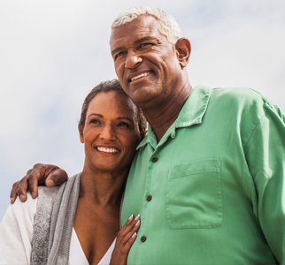 Older couple, with man's arm around woman's shoulders