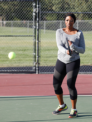 Woman playing tennis.