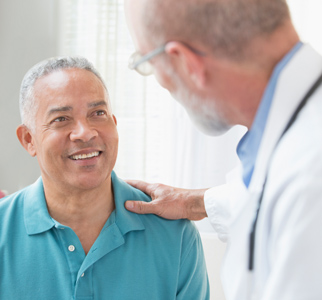 Healthcare provider talking with older man