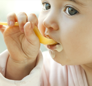 Young child eating from a spoon