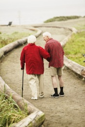 Older couple walking on path